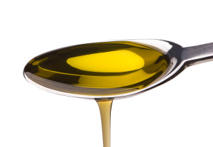 Olive oil in spoon